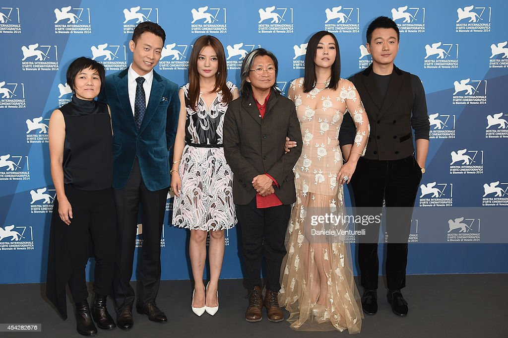 Producer Jojo Hui, actors <a gi-track='captionPersonalityLinkClicked' href=/galleries/search?phrase=Zhang+Yi+-+Actor&family=editorial&specificpeople=13530014 ng-click='$event.stopPropagation()'>Zhang Yi</a>, <a gi-track='captionPersonalityLinkClicked' href=/galleries/search?phrase=Zhao+Wei&family=editorial&specificpeople=540140 ng-click='$event.stopPropagation()'>Zhao Wei</a>, director <a gi-track='captionPersonalityLinkClicked' href=/galleries/search?phrase=Peter+Chan&family=editorial&specificpeople=582345 ng-click='$event.stopPropagation()'>Peter Chan</a>, actors <a gi-track='captionPersonalityLinkClicked' href=/galleries/search?phrase=Hao+Lei&family=editorial&specificpeople=606857 ng-click='$event.stopPropagation()'>Hao Lei</a> and <a gi-track='captionPersonalityLinkClicked' href=/galleries/search?phrase=Tong+Dawei&family=editorial&specificpeople=4384400 ng-click='$event.stopPropagation()'>Tong Dawei</a> attend 'Dearest' (Quin'ai De) Photocall during the 71st Venice Film Festival at Palazzo Del Casino on August 28, 2014 in Venice, Italy.