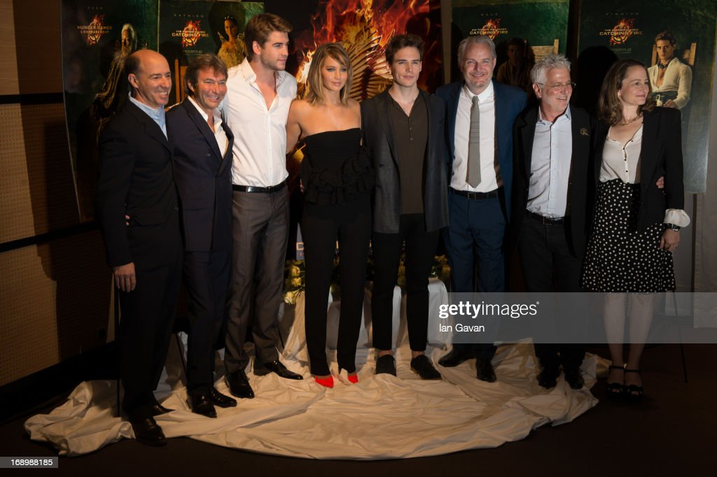 Producer <a gi-track='captionPersonalityLinkClicked' href=/galleries/search?phrase=Jon+Kilik&family=editorial&specificpeople=2442831 ng-click='$event.stopPropagation()'>Jon Kilik</a>, Lionsgate Films Co-Chairman Patrick Wachsberger, actor <a gi-track='captionPersonalityLinkClicked' href=/galleries/search?phrase=Liam+Hemsworth&family=editorial&specificpeople=6338547 ng-click='$event.stopPropagation()'>Liam Hemsworth</a>, actress <a gi-track='captionPersonalityLinkClicked' href=/galleries/search?phrase=Jennifer+Lawrence&family=editorial&specificpeople=1596040 ng-click='$event.stopPropagation()'>Jennifer Lawrence</a>, actor <a gi-track='captionPersonalityLinkClicked' href=/galleries/search?phrase=Sam+Claflin&family=editorial&specificpeople=7238693 ng-click='$event.stopPropagation()'>Sam Claflin</a> and director <a gi-track='captionPersonalityLinkClicked' href=/galleries/search?phrase=Francis+Lawrence&family=editorial&specificpeople=224820 ng-click='$event.stopPropagation()'>Francis Lawrence</a>, Lionsgate Films Co-Chairman <a gi-track='captionPersonalityLinkClicked' href=/galleries/search?phrase=Rob+Friedman&family=editorial&specificpeople=234962 ng-click='$event.stopPropagation()'>Rob Friedman</a> and producer <a gi-track='captionPersonalityLinkClicked' href=/galleries/search?phrase=Nina+Jacobson&family=editorial&specificpeople=209412 ng-click='$event.stopPropagation()'>Nina Jacobson</a> pose at the 'The Hunger Games: Catching Fire' photocall during The 66th Annual Cannes Film Festival at Nespresso Beach on May 18, 2013 in Cannes, France.