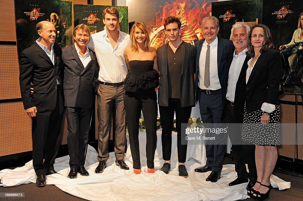 Producer <a gi-track='captionPersonalityLinkClicked' href=/galleries/search?phrase=Jon+Kilik&family=editorial&specificpeople=2442831 ng-click='$event.stopPropagation()'>Jon Kilik</a>, Lionsgate Motion Picture Group Co-Chairman Patrick Wachsberger, actors <a gi-track='captionPersonalityLinkClicked' href=/galleries/search?phrase=Liam+Hemsworth&family=editorial&specificpeople=6338547 ng-click='$event.stopPropagation()'>Liam Hemsworth</a>, <a gi-track='captionPersonalityLinkClicked' href=/galleries/search?phrase=Jennifer+Lawrence&family=editorial&specificpeople=1596040 ng-click='$event.stopPropagation()'>Jennifer Lawrence</a>, <a gi-track='captionPersonalityLinkClicked' href=/galleries/search?phrase=Sam+Claflin&family=editorial&specificpeople=7238693 ng-click='$event.stopPropagation()'>Sam Claflin</a>, director <a gi-track='captionPersonalityLinkClicked' href=/galleries/search?phrase=Francis+Lawrence&family=editorial&specificpeople=224820 ng-click='$event.stopPropagation()'>Francis Lawrence</a>, Lionsgate Motion Picture Group Co-Chairman <a gi-track='captionPersonalityLinkClicked' href=/galleries/search?phrase=Rob+Friedman&family=editorial&specificpeople=234962 ng-click='$event.stopPropagation()'>Rob Friedman</a> and producer <a gi-track='captionPersonalityLinkClicked' href=/galleries/search?phrase=Nina+Jacobson&family=editorial&specificpeople=209412 ng-click='$event.stopPropagation()'>Nina Jacobson</a> attend The Hunger Games: Catching Fire photocall at the 2013 Cannes Film Festival at Majestic Barierre on May 18, 2013 in Cannes, France.