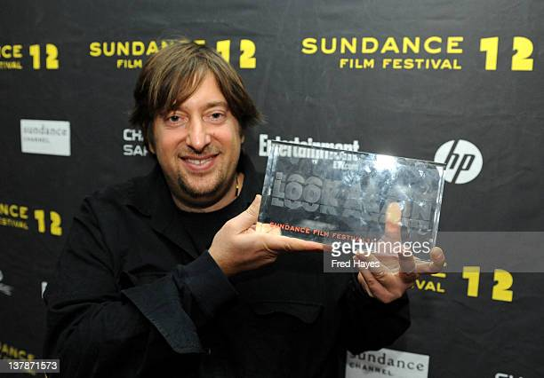 Producer Jonathan Schwartz poses with the award for US Dramatic Special Jury Prize for Excellence in Independent Film Producing for 'Smashed' and...