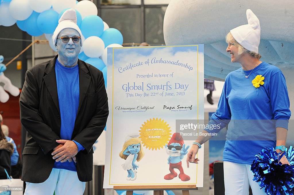 Producer Jordan Kerner and Veronique Culliford, the daughter of creator of The Smurfs, cartoonist Peyo, pose during a ceremony as part as Global Smurfs Day celebrations on June 22, 2013 in Brussels, Belgium.