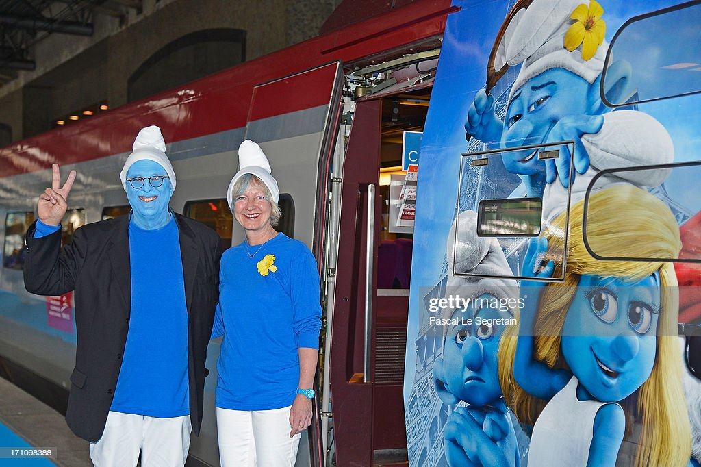 Producer Jordan Kerner and Veronique Culliford, the daughter of cartoonist Peyo, the creator of The Smurfs, prepare to board a branded high speed train from Brussels to Paris as part of Global Smurfs Day celebrations on June 22, 2013 at Brussels railway station, Belgium.