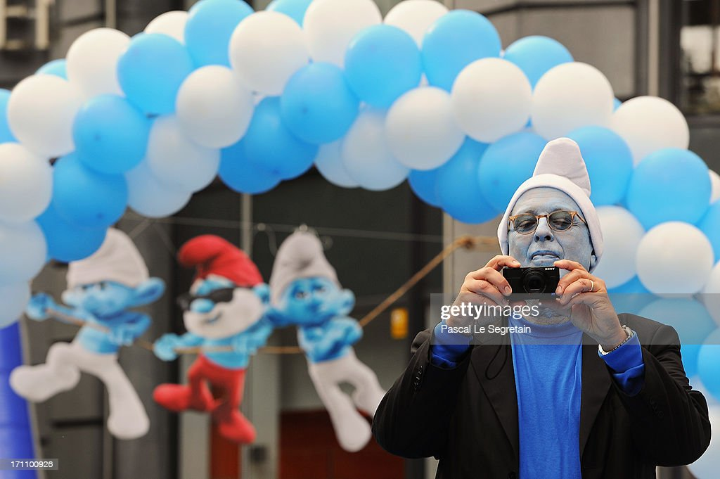 Producer Jordan Kerner takes a photo during a ceremony as part as Global Smurfs Day celebrations on June 22, 2013 in Brussels, Belgium.
