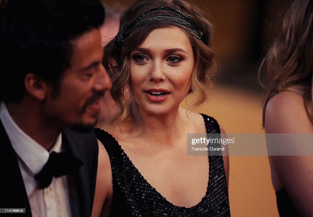 Producer Josh Mond (L) and actress Elizabeth Olsen attend the 'Martha Marcy May Marlene' premiere during the 64th Cannes Film Festival at the Palais des Festivals on May 15, 2011 in Cannes, France.