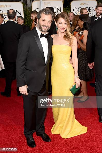 Producer Judd Apatow and actress Leslie Mann attend the 72nd Annual Golden Globe Awards at The Beverly Hilton Hotel on January 11 2015 in Beverly...