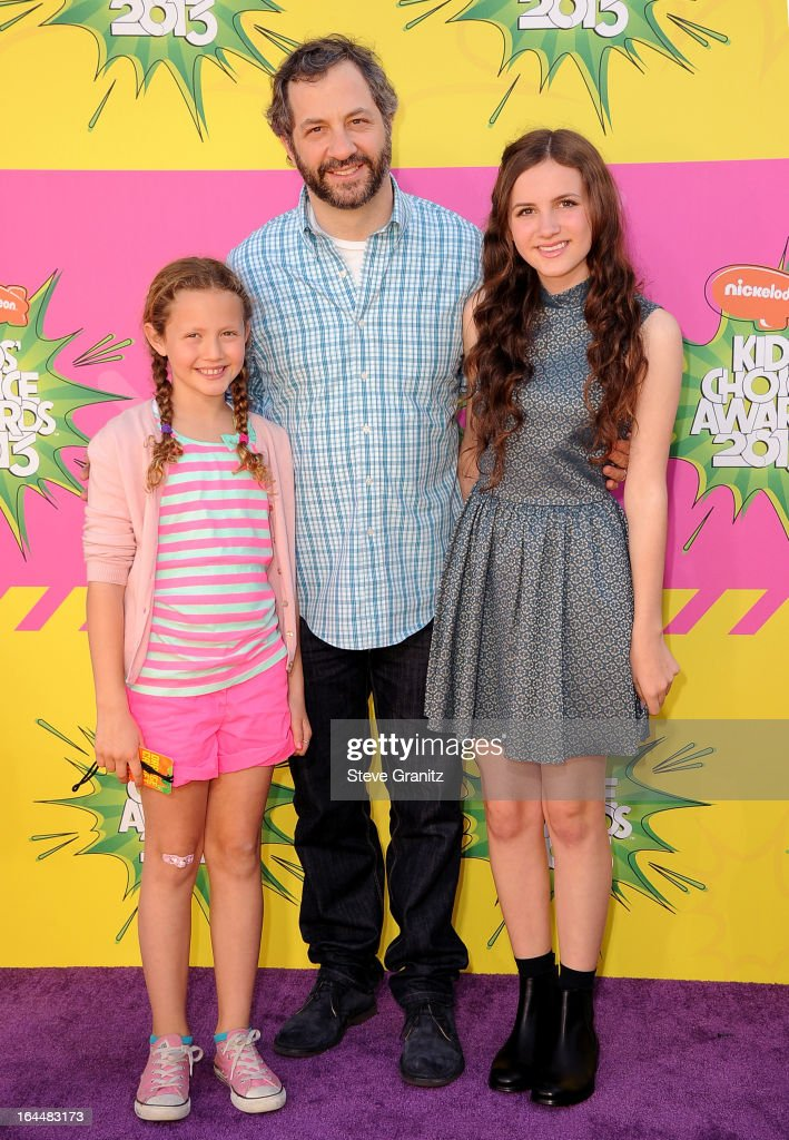Producer Judd Apatow (C) with daughters Iris Apatow (L) and Maude Apatow (R) arrive at Nickelodeon's 26th Annual Kids' Choice Awards at USC Galen Center on March 23, 2013 in Los Angeles, California.