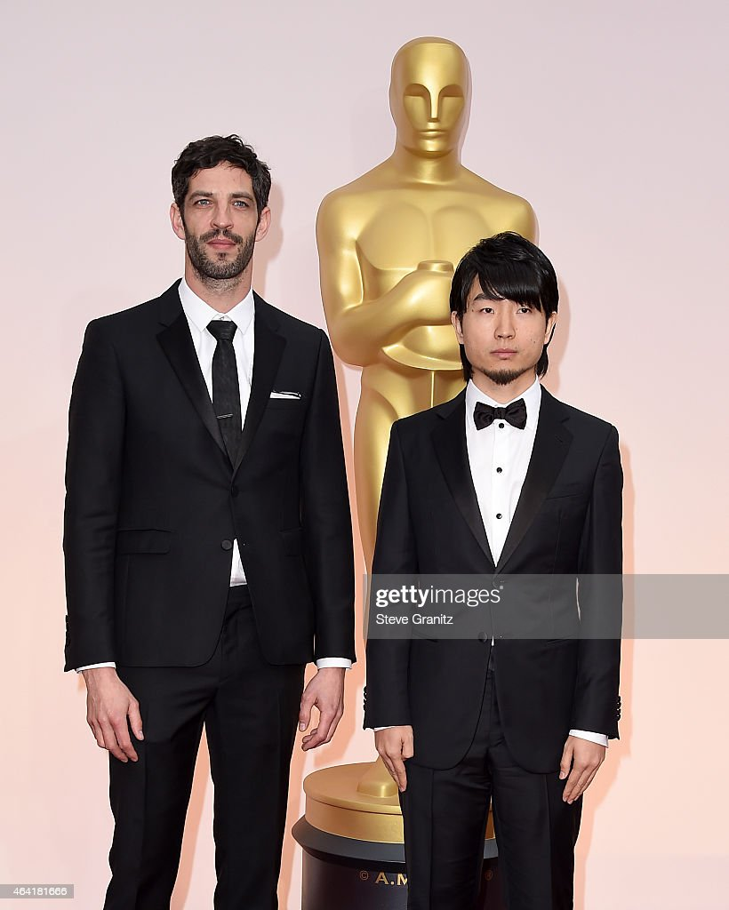 Producer <a gi-track='captionPersonalityLinkClicked' href=/galleries/search?phrase=Julien+Feret&family=editorial&specificpeople=4110266 ng-click='$event.stopPropagation()'>Julien Feret</a> (L) and writerdirector Hu Wei attend the 87th Annual Academy Awards at Hollywood & Highland Center on February 22, 2015 in Hollywood, California.