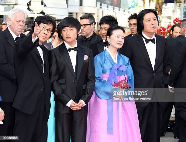 Producer Jundong Lee actor David Lee actress Jeonghee Yoon and director Changdong Lee attend the premiere of 'Poetry' held at the Palais des...