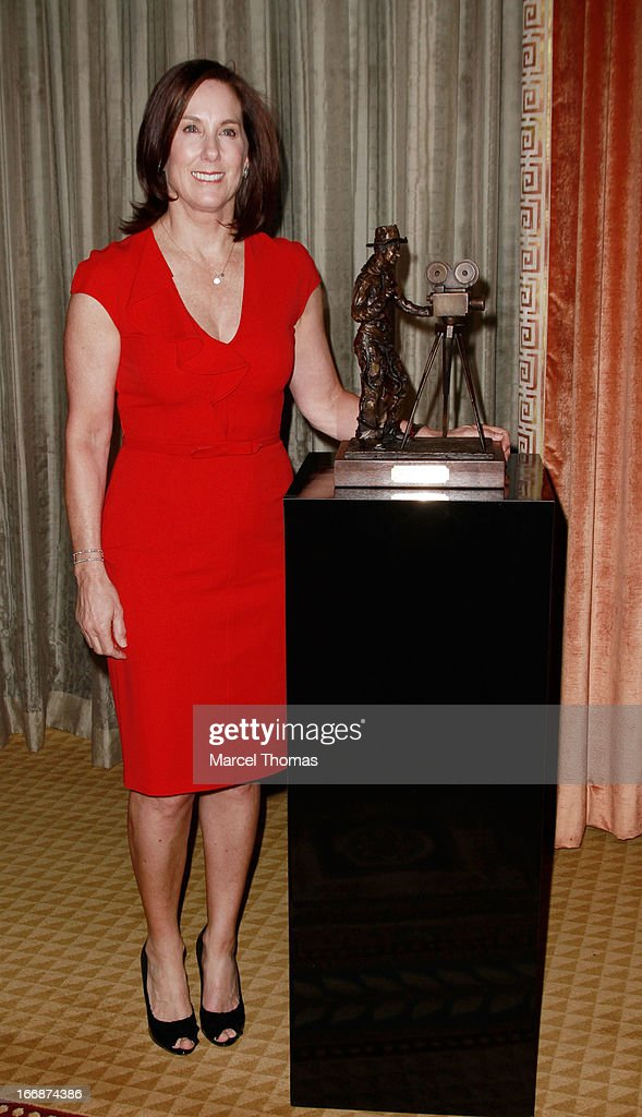 Producer <a gi-track='captionPersonalityLinkClicked' href=/galleries/search?phrase=Kathleen+Kennedy+-+Film+Producer&family=editorial&specificpeople=215256 ng-click='$event.stopPropagation()'>Kathleen Kennedy</a> poses with her Will Roger's Pioneer Award during CinemaCon 2013 at Caesars Palace at on April 17, 2013 in Las Vegas, Nevada.