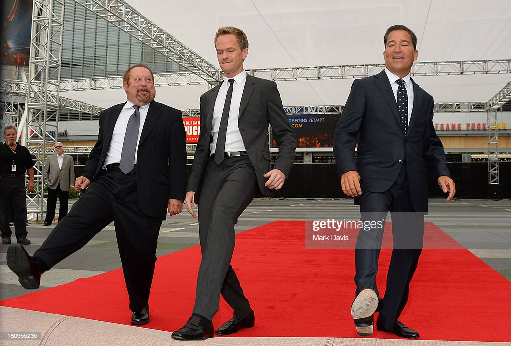 Producer Ken Ehrlich, actor Neil Patrick Harris and Chairman & CEO of the Academy of Television Arts & Sciences Bruce Rosenblum roll out the red carpet for the 65th Primetime Emmy Awards at L.A. Live on September 18, 2013 in Los Angeles, California.
