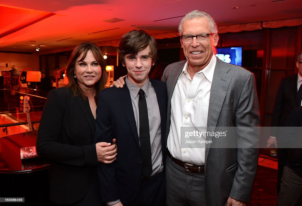 Producer Kerry Ehrin, actor Freddie Highmore and executive producer Carlton Cuse attend A&E's 'Bates Motel' Premiere Party on March 12, 2013 in West Hollywood, California.
