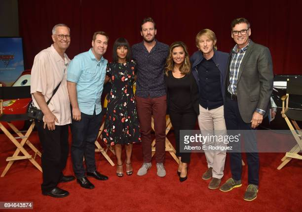 Producer Kevin Reher director Brian Fee actors Kerry Washington Armie Hammer Cristela Alonzo Owen Wilson and Ray Evernham pose at the 'Cars 3' Press...