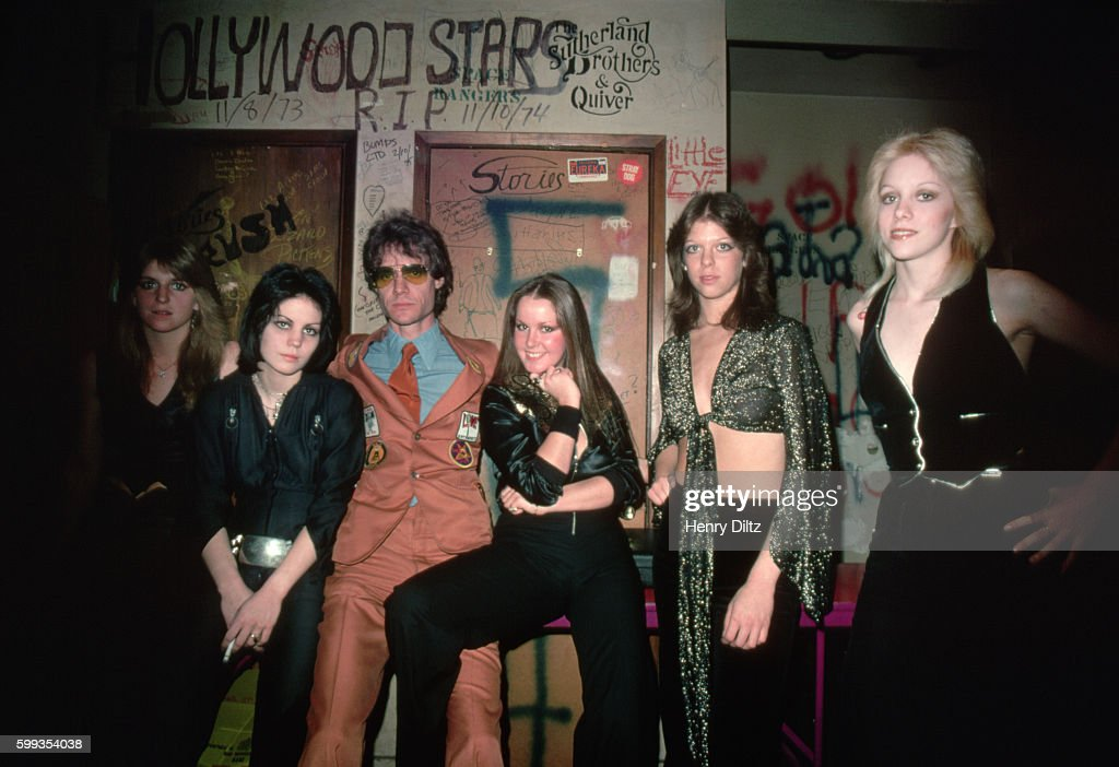 Producer Kim Fowley (man in center) stands with Joan Jett, Lita Ford, Jackie Fox, and Cherie Currie of The Runaways at Los Angeles' Whiskey a Go Go.