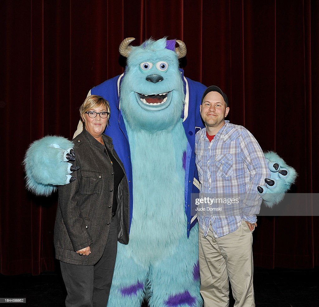 Producer Kori Rae and Director Dan Scanlon with the Pixar character Sulley at Hopkins Center Spaulding Auditorium at Dartmouth College on October 13, 2013 in Hanover, New Hampshire.