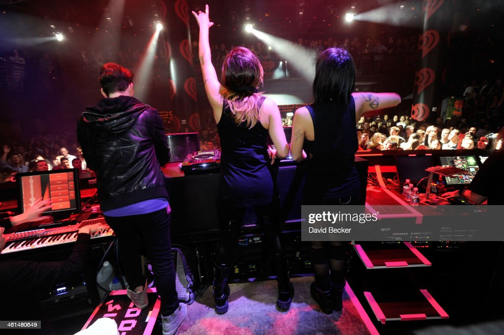 Producer Kris 'Rain Man' Trindl, singer/songwriters Jahan Yousaf and Yasmine Yousaf of Krewella perform onstage at a private party celebrating CES 2014 hosted by iHeartRadio featuring a live performance by Krewella at Haze Nightclub at the Aria Resort & Casino at CityCenter on January 8, 2014 in Las Vegas, Nevada.