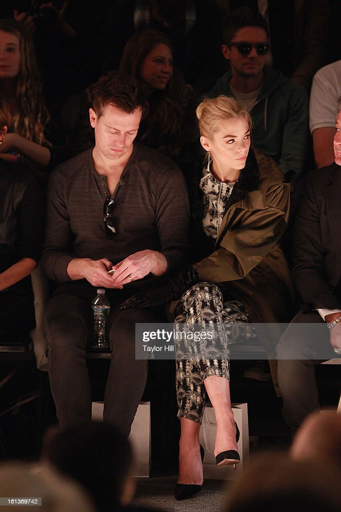 Producer Kyle Newman and actress Jaime King, with Topher Grace behind them in the 2nd row, attend the Lela Rose Fall 2013 Mercedes-Benz Fashion Show at The Studio at Lincoln Center on February 10, 2013 in New York City.