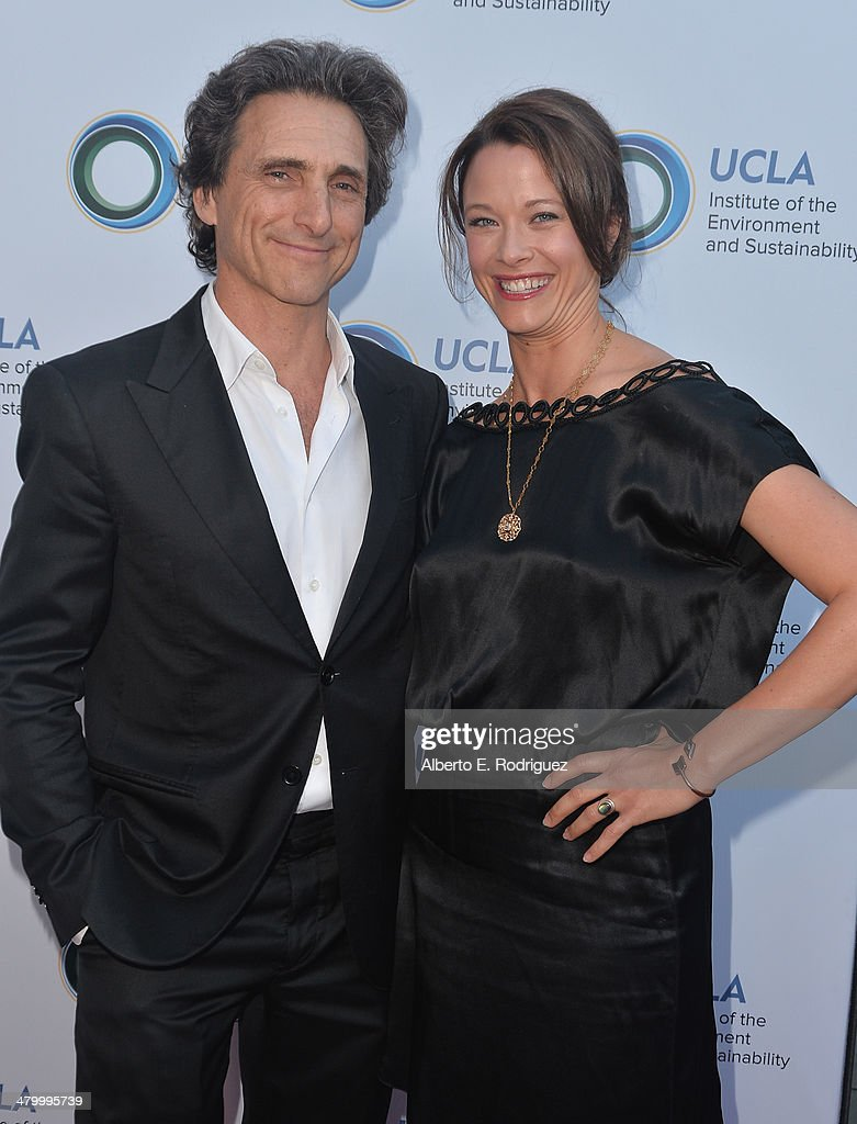 Producer Lawrence Bender and actress Scottie Thompson attend An Evening of Environmental Excellence presented by the UCLA Institute of the Environment and Sustainability on March 21, 2014 in Beverly Hills, California.