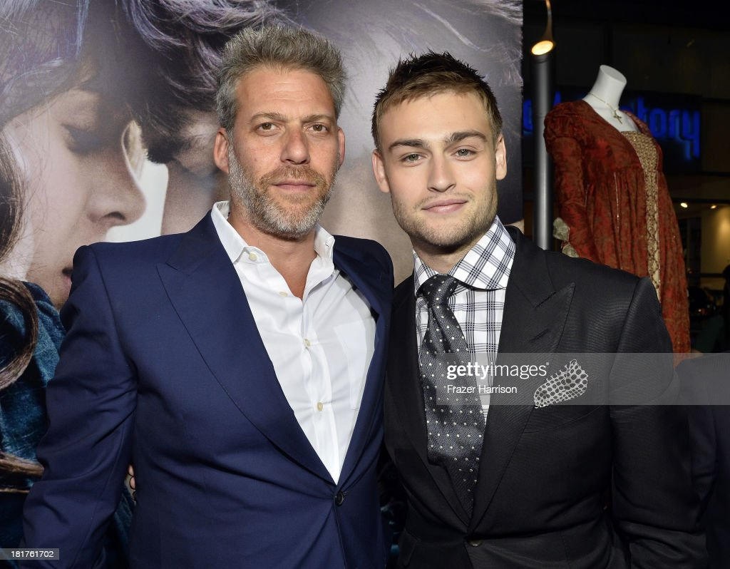 Producer Lawrence Elman (L) and actor Douglas Booth arrive at the premiere of Relativity Media's 'Romeo And Juliet' at ArcLight Cinemas on September 24, 2013 in Hollywood, California.