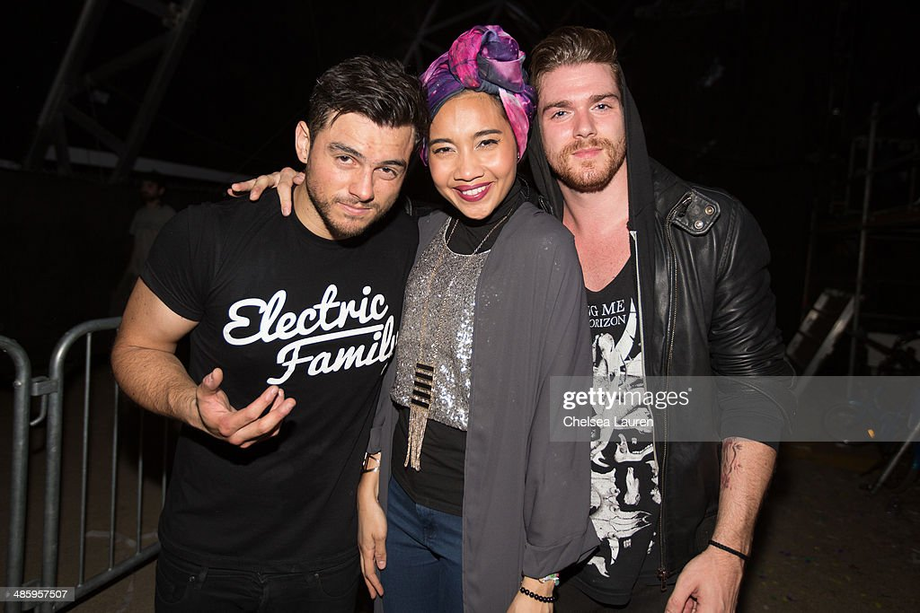 Producer Leighton James of Adventure Club, singer Yuna and producer Christian Srigley of Adventure Club pose backstage at the Coachella valley music and arts festival at The Empire Polo Club on April 20, 2014 in Indio, California.