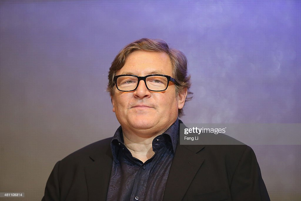 Producer Lorenzo di Bonaventura attends the press conference for Beijing premiere screening of 'Transformers Age of Extinction' at Pangu Hotel on...