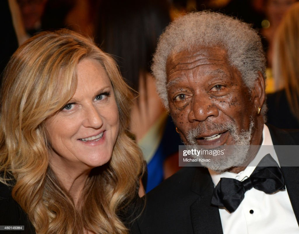 Producer Lori McCreary (L) and actor Morgan Freeman attend the 2014 AFI Life Achievement Award: A Tribute to Jane Fonda at the Dolby Theatre on June 5, 2014 in Hollywood, California. Tribute show airing Saturday, June 14, 2014 at 9pm ET/PT on TNT.