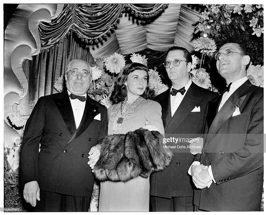 Producer Louis B. Mayer with actress <a gi-track='captionPersonalityLinkClicked' href=/galleries/search?phrase=Paulette+Goddard&family=editorial&specificpeople=207156 ng-click='$event.stopPropagation()'>Paulette Goddard</a>, producer Hunt Stromberg and director <a gi-track='captionPersonalityLinkClicked' href=/galleries/search?phrase=George+Cukor&family=editorial&specificpeople=226979 ng-click='$event.stopPropagation()'>George Cukor</a> pose during the premire of MGM movie ' The Women' in Los Angeles, California.