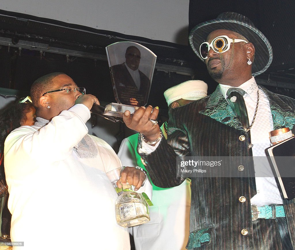 Producer L.T. Hutton receives the lifetime acheivement award from Bishop Don 'Magic' Juan (R) during The Official International Players Ball 2012 and birthday celebration for Arch Bishop Don Magic Juan at Key Club on December 8, 2012 in West Hollywood, California.