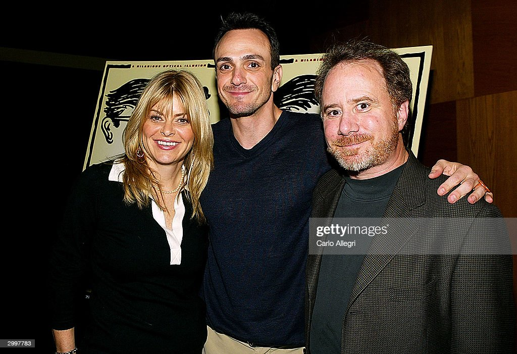 Producer Lysa Hayland-Heslov, (L) Actor/Director Hank Azaria (C) and writer Andrew Hill Newman pose for a photo screening of 'Nobody's Perfect' at the Writers Guild February 19, 2004 in Los Angeles, California.