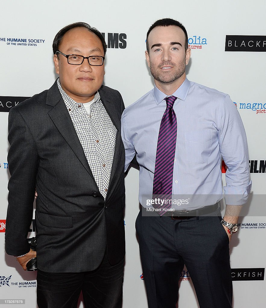 Producer Manuel Oteyza (L) and former Seaworld trainer John Hargrove arrive at Magnolia Pictures Los Angeles Premiere of 'Blackfish' at ArcLight Cinemas on July 10, 2013 in Hollywood, California.