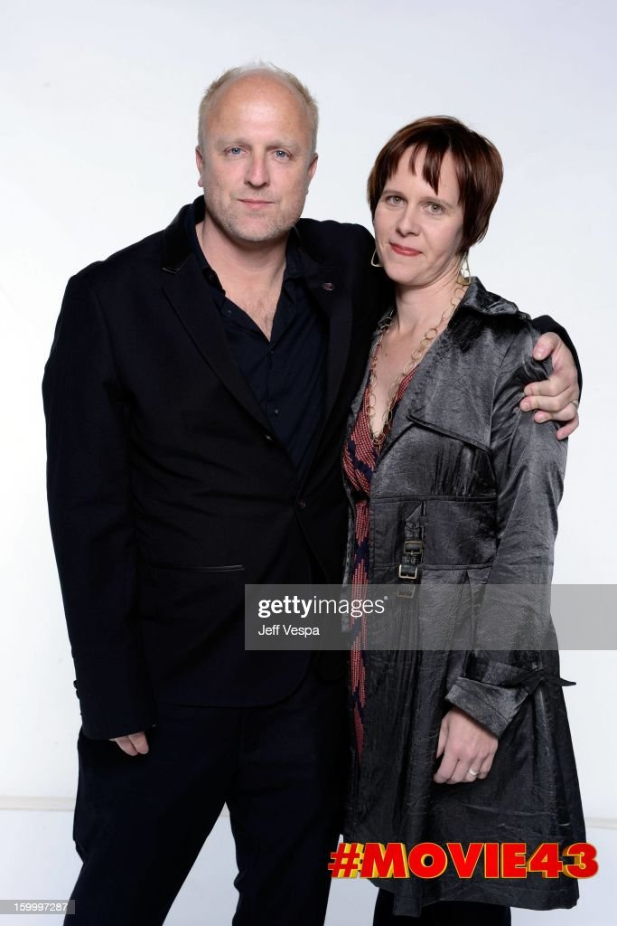 Producer Marc Ambrose and Marita Taube pose for a portrait during Relativity Media's 'Movie 43' Los Angeles premiere at TCL Chinese Theatre on January 23, 2013 in Hollywood, California.