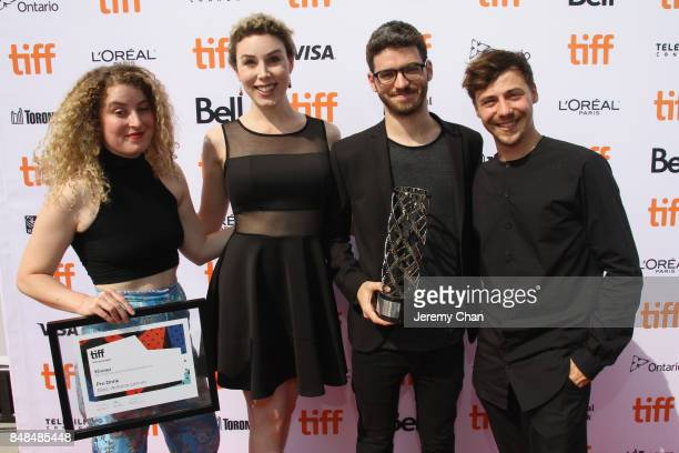 Producer Maria Gracia Turgeon Pascale Drevillon director MarcAntoine Lemire and Alex Trahan pose after being awarded with The IWC Short Cuts Award...