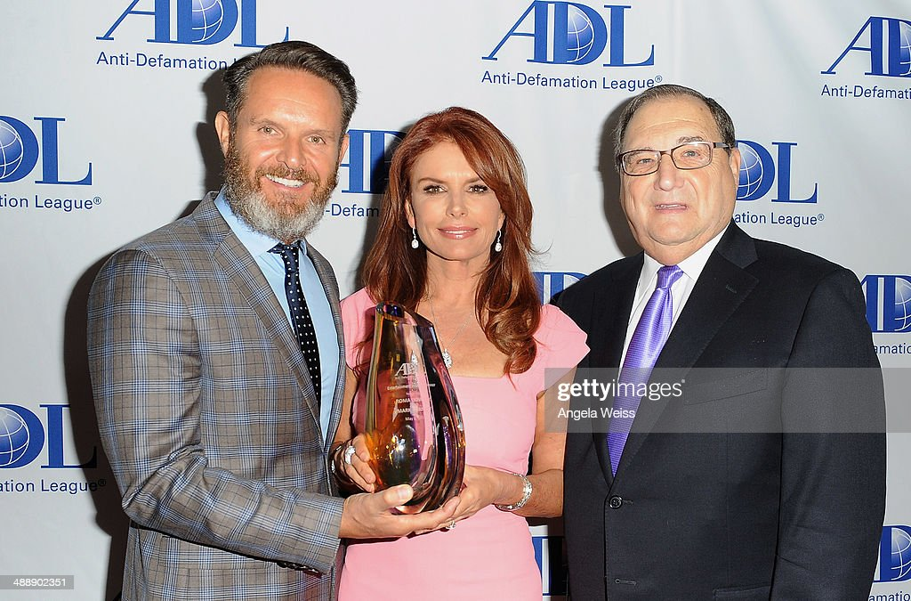 Producer <a gi-track='captionPersonalityLinkClicked' href=/galleries/search?phrase=Mark+Burnett&family=editorial&specificpeople=204697 ng-click='$event.stopPropagation()'>Mark Burnett</a>, actress/producer <a gi-track='captionPersonalityLinkClicked' href=/galleries/search?phrase=Roma+Downey&family=editorial&specificpeople=214162 ng-click='$event.stopPropagation()'>Roma Downey</a> and Chairman Defamation League National Director <a gi-track='captionPersonalityLinkClicked' href=/galleries/search?phrase=Abraham+Foxman&family=editorial&specificpeople=2499499 ng-click='$event.stopPropagation()'>Abraham Foxman</a> arrive at the Anti-Defamation League entertainment industry dinner honoring <a gi-track='captionPersonalityLinkClicked' href=/galleries/search?phrase=Roma+Downey&family=editorial&specificpeople=214162 ng-click='$event.stopPropagation()'>Roma Downey</a> and <a gi-track='captionPersonalityLinkClicked' href=/galleries/search?phrase=Mark+Burnett&family=editorial&specificpeople=204697 ng-click='$event.stopPropagation()'>Mark Burnett</a> at The Beverly Hilton Hotel on May 8, 2014 in Beverly Hills, California.