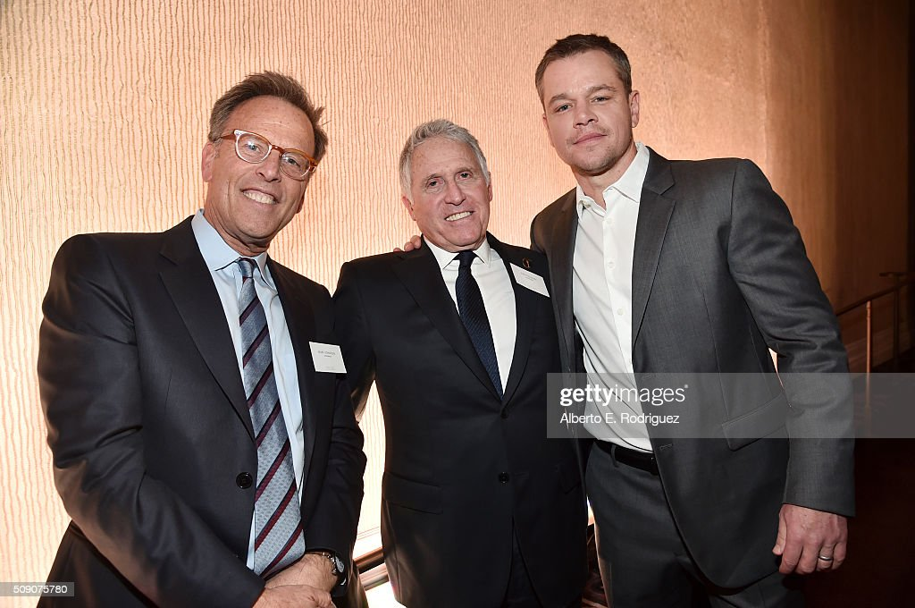 Producer Mark Johnson, former Warner Bros Domestic Distribution president Dan Fellman and actor <a gi-track='captionPersonalityLinkClicked' href=/galleries/search?phrase=Matt+Damon&family=editorial&specificpeople=202093 ng-click='$event.stopPropagation()'>Matt Damon</a> attend the 88th Annual Academy Awards nominee luncheon on February 8, 2016 in Beverly Hills, California.
