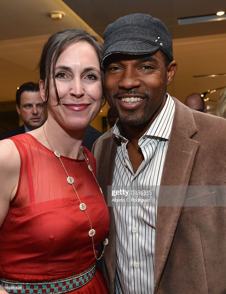 Producer Martha Adams and actor <a gi-track='captionPersonalityLinkClicked' href=/galleries/search?phrase=Jason+George&family=editorial&specificpeople=2566184 ng-click='$event.stopPropagation()'>Jason George</a> attend a special screening of 10x10's 'Girl Rising' hosted by Intel on March 7, 2013 in Los Angeles, California.