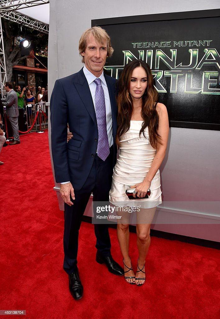 Producer Michael Bay (L) and actress Megan Fox attend the premiere of Paramount Pictures' 'Teenage Mutant Ninja Turtles' at Regency Village Theater on August 3, 2014 in Westwood, California.