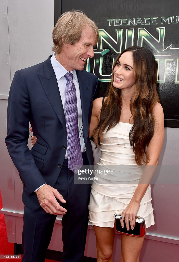 Producer <a gi-track='captionPersonalityLinkClicked' href=/galleries/search?phrase=Michael+Bay&family=editorial&specificpeople=240532 ng-click='$event.stopPropagation()'>Michael Bay</a> (L) and actress <a gi-track='captionPersonalityLinkClicked' href=/galleries/search?phrase=Megan+Fox&family=editorial&specificpeople=2239934 ng-click='$event.stopPropagation()'>Megan Fox</a> attend the premiere of Paramount Pictures' 'Teenage Mutant Ninja Turtles' at Regency Village Theater on August 3, 2014 in Westwood, California.