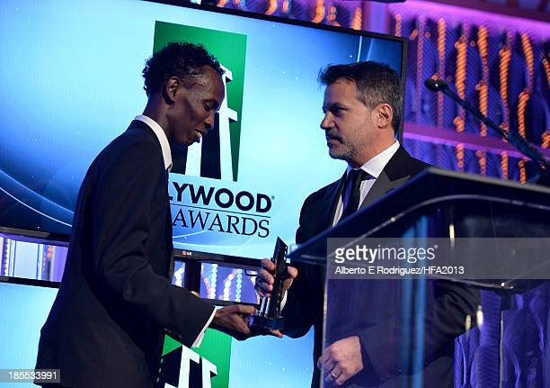 Producer Michael De Luca accepts the Hollywood Producer Award for 'Captain Phillips' from actor Barkhad Abdi during the 17th annual Hollywood Film...