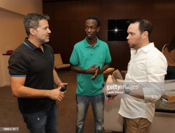 Producer Michael De Luca actor Barkhad Abdi and producer Dana Brunetti attend Deadline Hollywood's The Contenders on November 2 2013 in Beverly Hills...