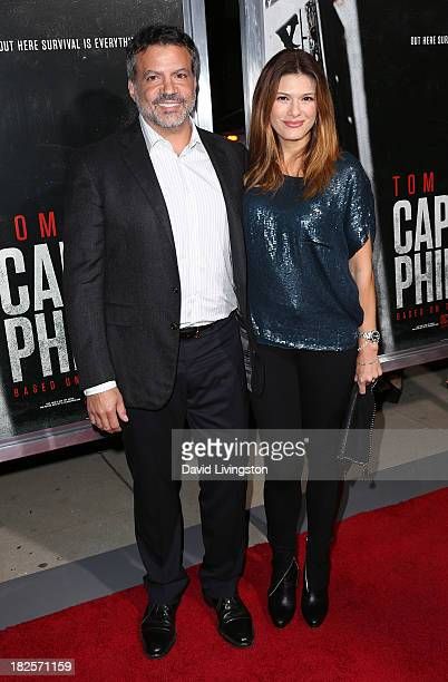 Producer Michael De Luca and wife Angelique De Luca attend the premiere of Columbia Pictures' 'Captain Phillips' at the Academy of Motion Picture...
