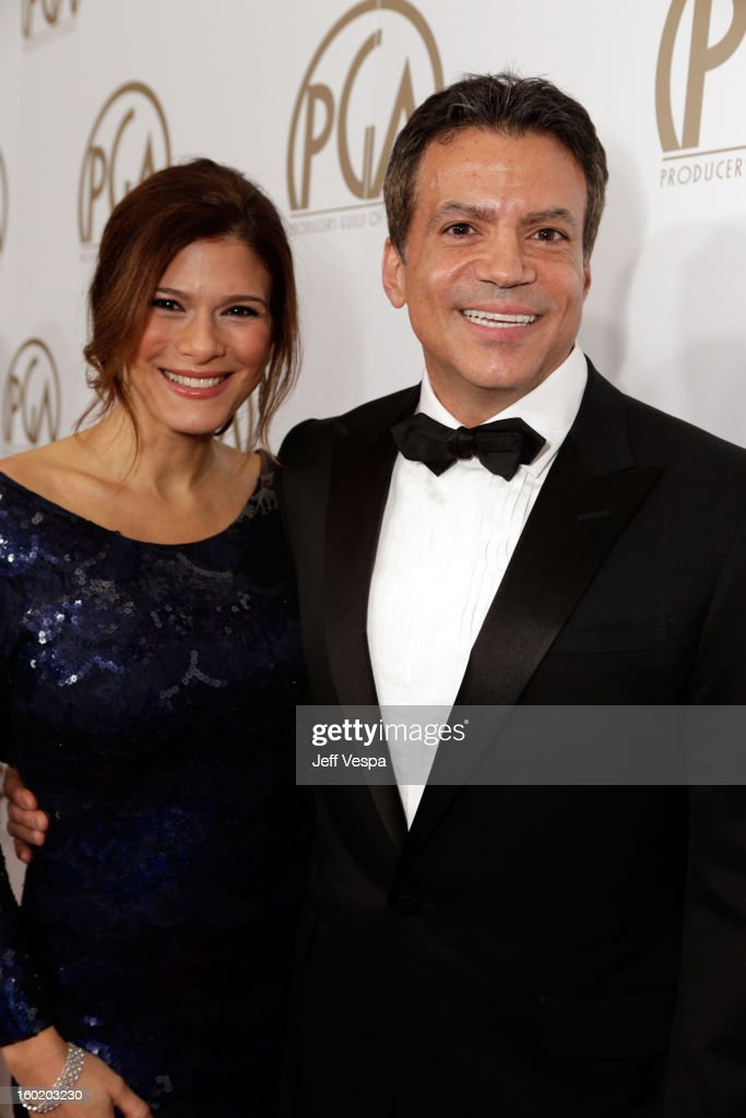 Producer Michael DeLuca (R) and Angelique Madrid arrive at the 24th Annual Producers Guild Awards held at The Beverly Hilton Hotel on January 26, 2013 in Beverly Hills, California.