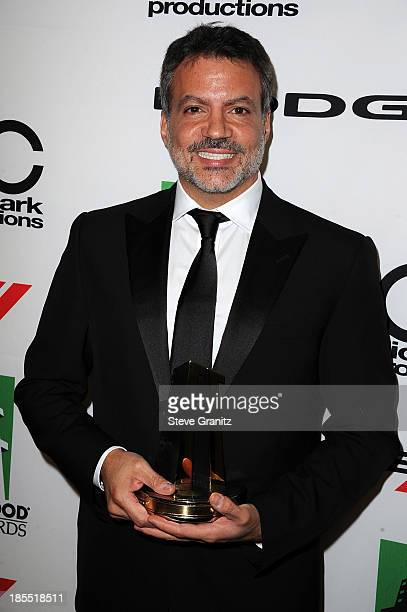 Producer Michael DeLuca poses in the press room during the 17th Annual Hollywood Film Awards at The Beverly Hilton Hotel on October 21 2013 in...