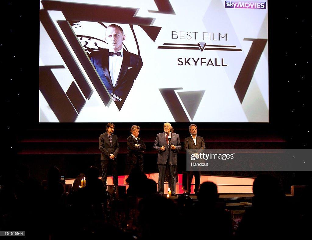 Producer Michael G Wilson speaks as he receives the Best Film award for 'Skyfall' with director Sam Mendes (R) and guests at the Jameson Empire Awards at Grosvenor House on March 24, 2013 in London, England. Renowned for being one of the most laid-back awards shows in the British movie calendar, the Jameson Empire Awards celebrate the film industry's success stories of the year with Empire Magazine readers voting for the winners. Visit empireonline.com/awards2013 for more information.
