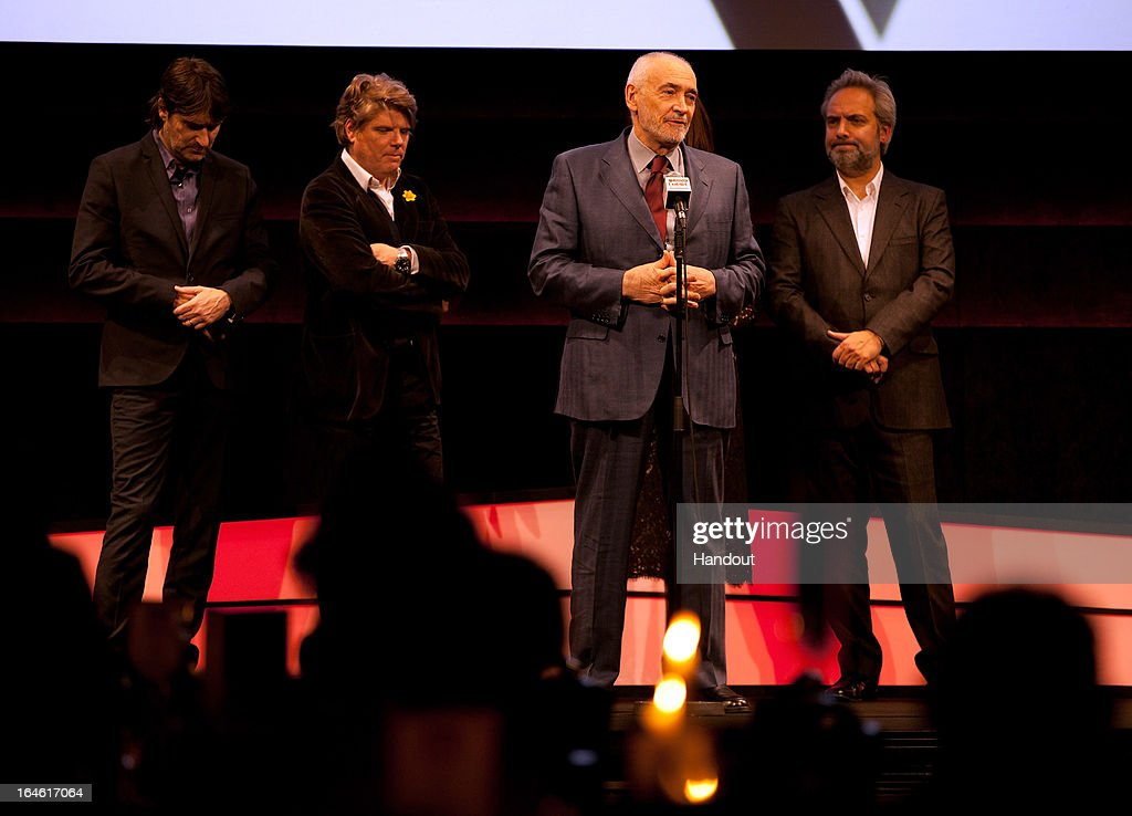 Producer Michael G Wilson speaks as he receives the Best Film award for 'Skyfall' with director <a gi-track='captionPersonalityLinkClicked' href=/galleries/search?phrase=Sam+Mendes&family=editorial&specificpeople=211300 ng-click='$event.stopPropagation()'>Sam Mendes</a> (R) and guests at the Jameson Empire Awards at Grosvenor House on March 24, 2013 in London, England. Renowned for being one of the most laid-back awards shows in the British movie calendar, the Jameson Empire Awards celebrate the film industry's success stories of the year with Empire Magazine readers voting for the winners. Visit empireonline.com/awards2013 for more information.