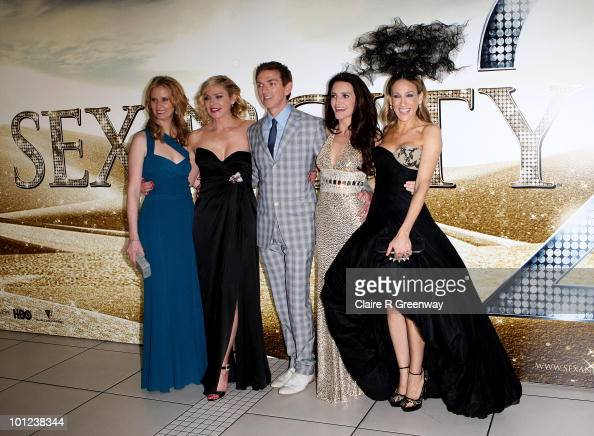 Producer Michael Patrick King and actresses Cynthia Nixon Kim Cattrall Kristin Davis and Sarah Jessica Parker arrive at the UK premiere of 'Sex And...