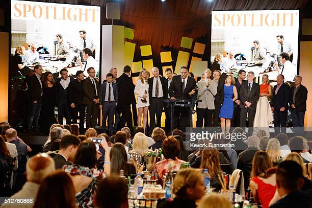 Producer Michael Sugar accepts the Best Feature award for 'Spotlight' onstage with members of the film's cast and crew as well as some of the real...