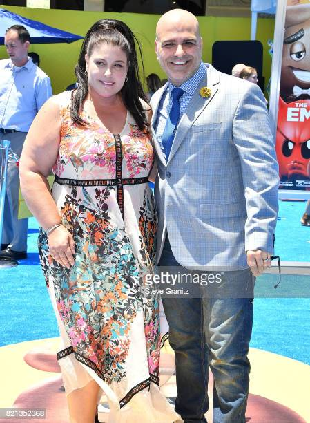 Producer Michelle Raimo Kouyate and director Tony Leondis arrives at the Premiere Of Columbia Pictures And Sony Pictures Animation's 'The Emoji...
