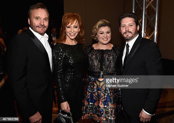 TV Producer Narvel Blackstock singers Reba McEntire Kelly Clarkson and Brandon Blackstock attend Muhammad Ali's Celebrity Fight Night XXI at the JW...