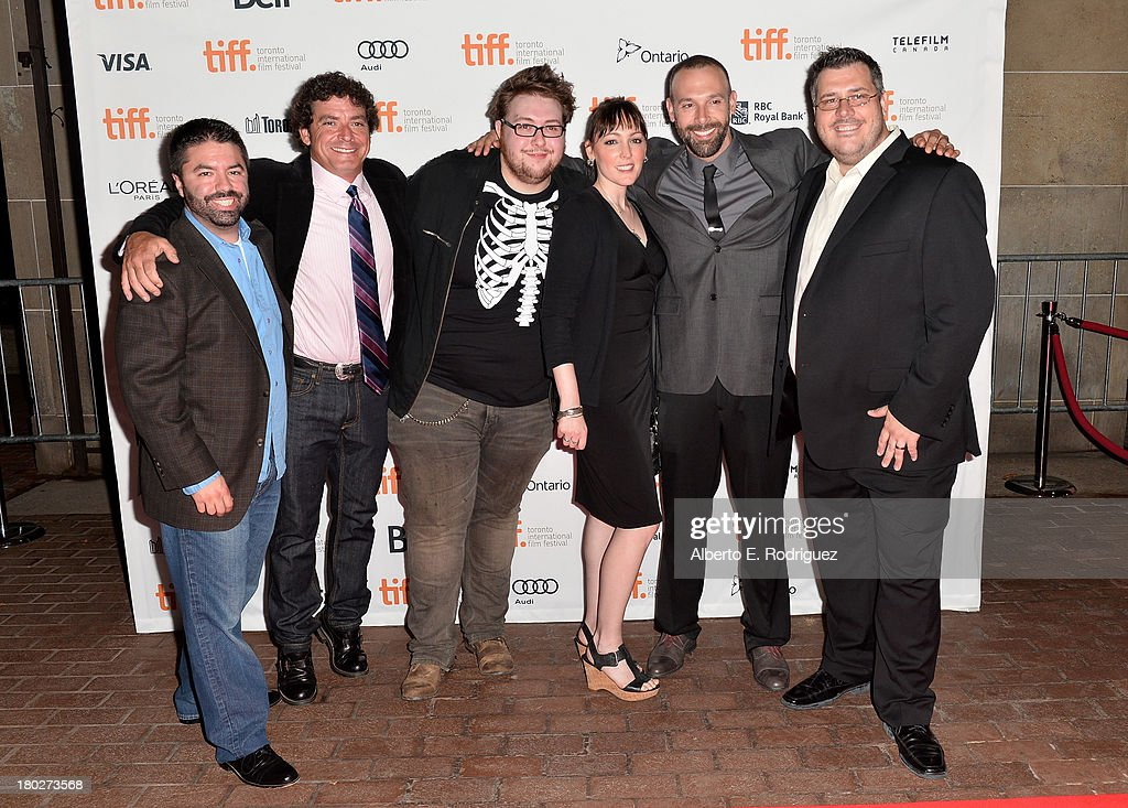 Producer Nicholas Delmenico, guests, actress Susan T. Travers, actor Michael A. LoCicero and producer Anthony Ambrosino arrive at the 'Almost Human' Premiere during the 2013 Toronto International Film Festival at Ryerson Theatre on September 10, 2013 in Toronto, Canada.