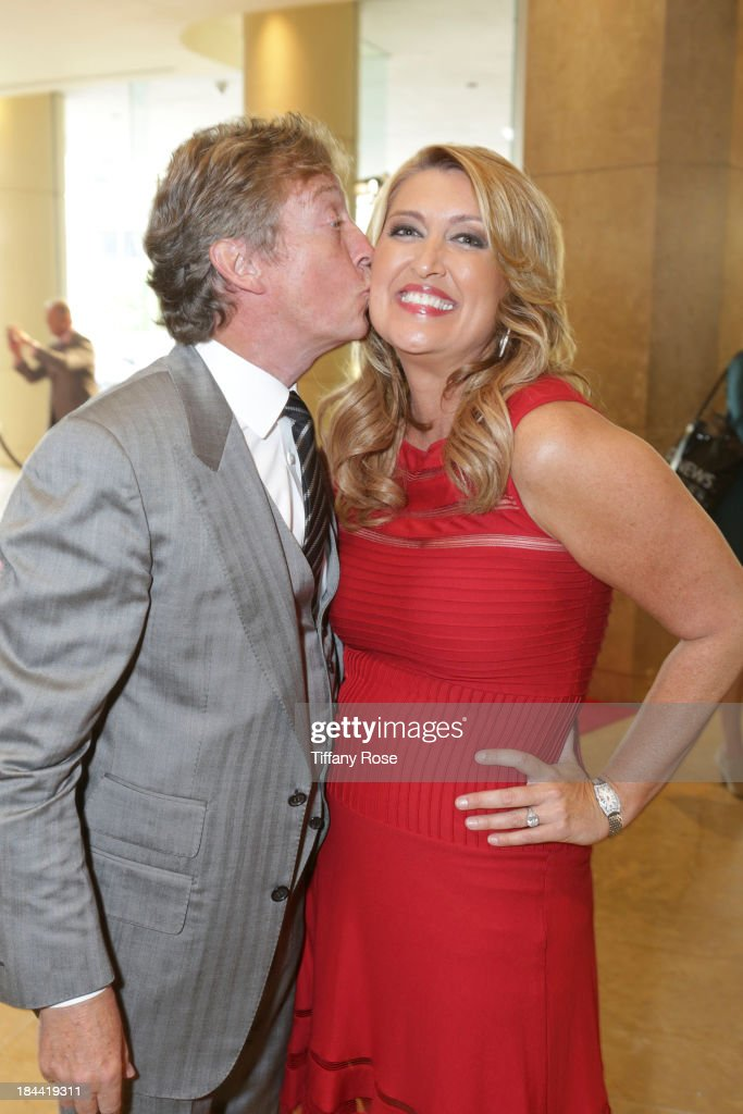 Producer Nigel Lythgoe and news anchor Wendy Burch attend the Good News Foundation's Feel Good event of the year honoring Maria Shriver with the Lifetime Achievement Award at The Beverly Hilton Hotel on October 13, 2013 in Beverly Hills, California.
