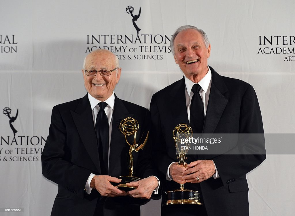 Producer Norman Lear (L) and actor Alan Alda (R) pose with their 40th Anniversary Special Founders Award at the 40th International Emmy Awards November 19, 2012 in New York. AFP PHOTO/Stan HONDA